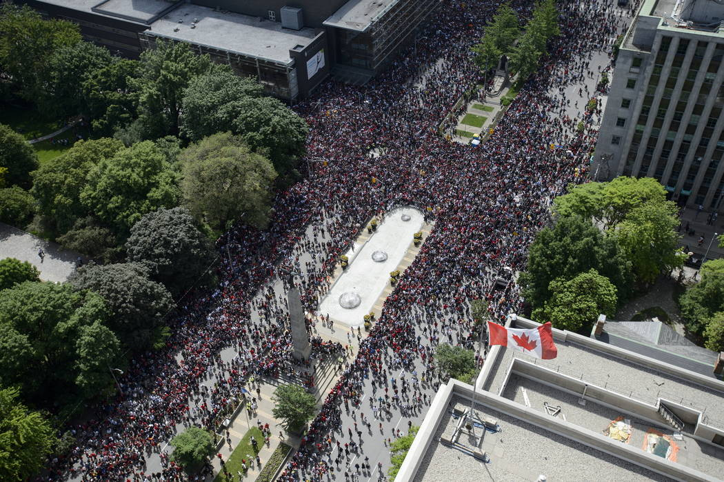 Fans fill the intersection of Queen St. West and University Avenue during the 2019 Toronto Rapt ...