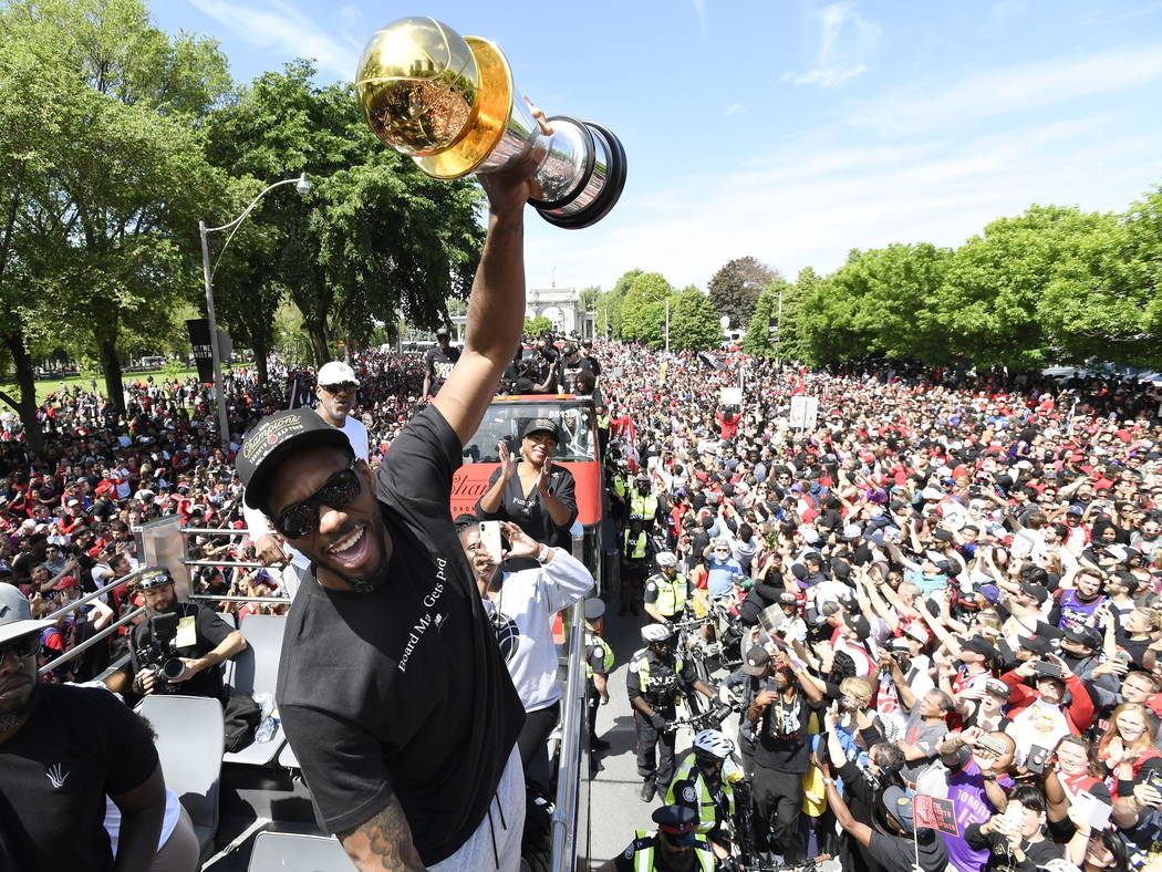 Toronto Raptors forward Kawhi Leonard holds his playoffs MVP trophy during the NBA basketball c ...