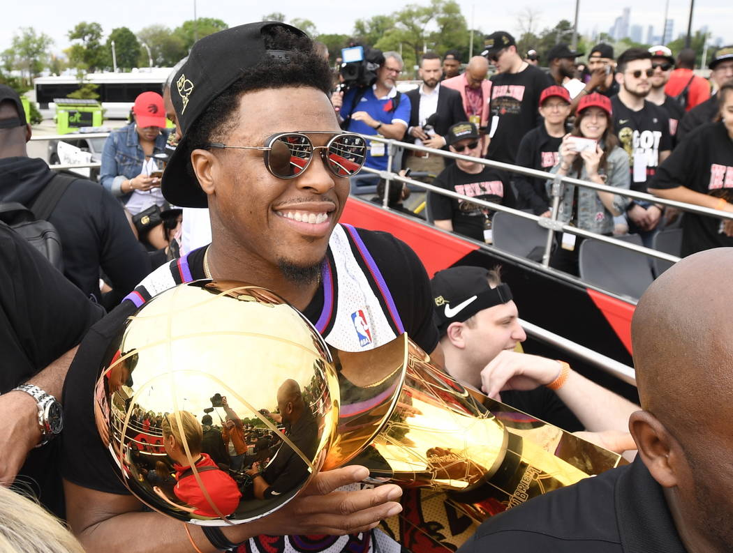 Toronto Raptors guard Kyle Lowry holds the Larry O'Brien Championship Trophy during the 2019 To ...