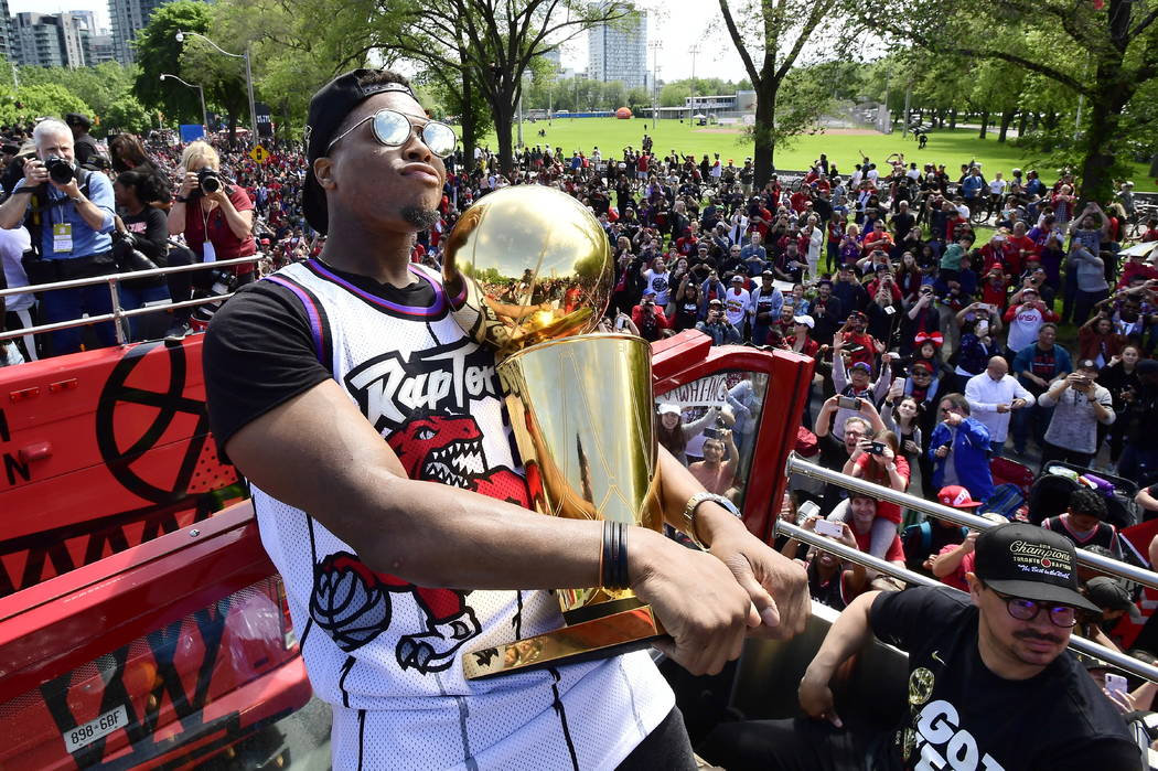 Toronto Raptors guard Kyle Lowry holds the Larry O'Brien Championship Trophy during the NBA bas ...