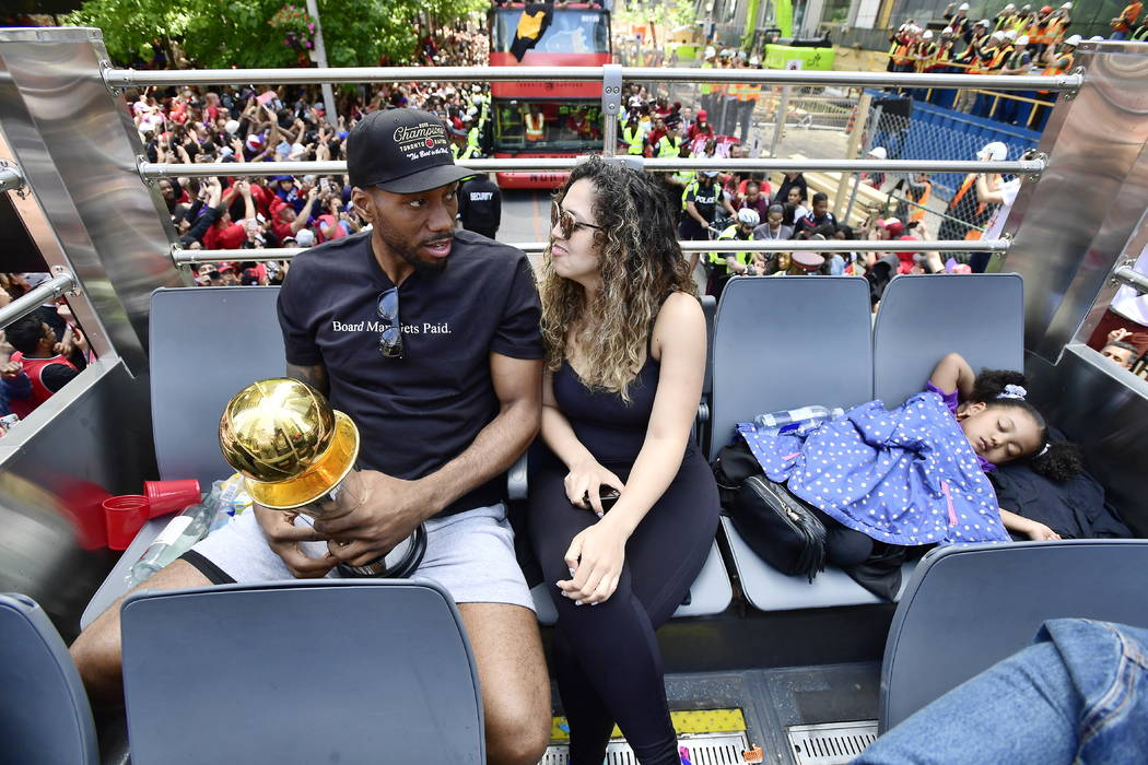 Toronto Raptors forward Kawhi Leonard and his girlfriend Kishele Shipley take a seat as their d ...