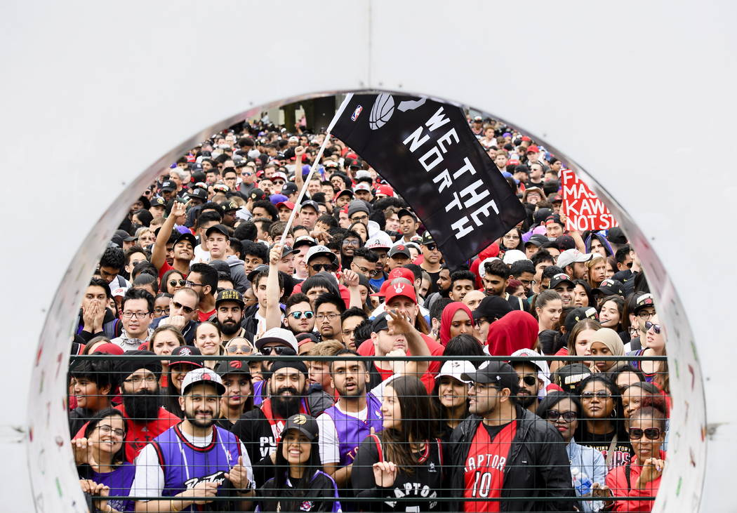 Thousands of fans gather to cheers on the Toronto Raptors during the NBA basketball team's cham ...