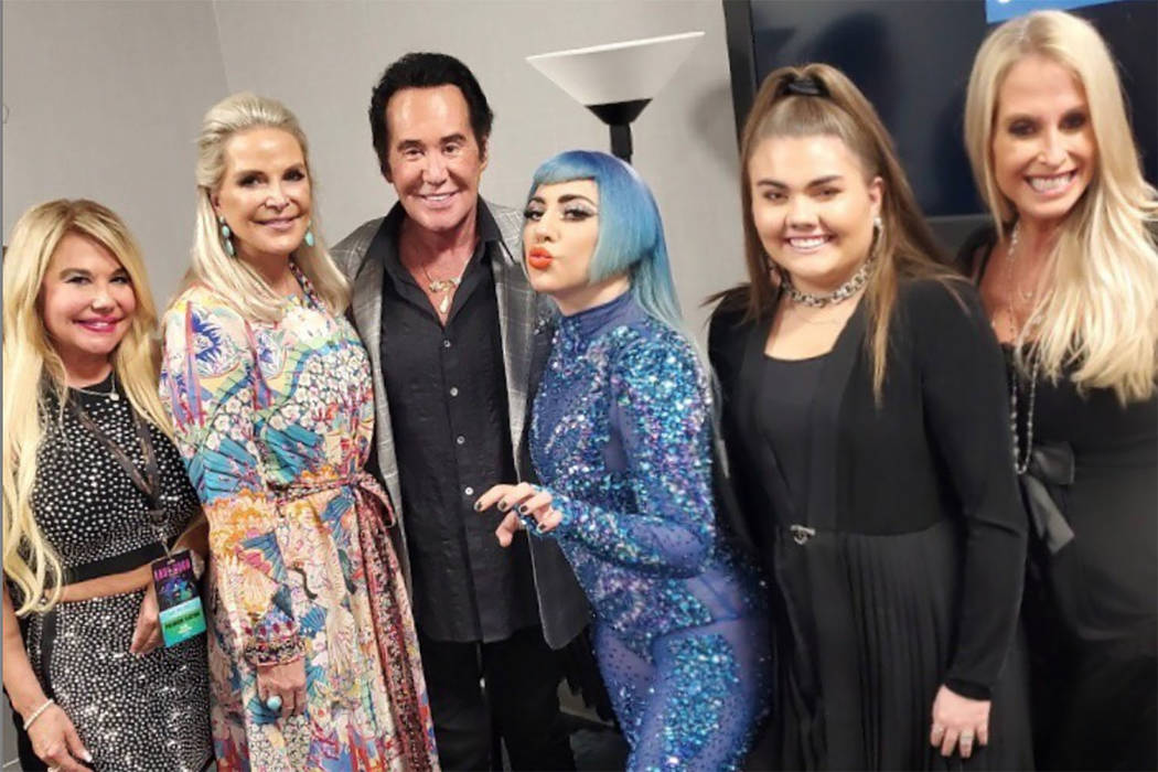 Lady Gaga greets Wayne Newton and his friends and family backstage at her 'Enigma' show at Park ...