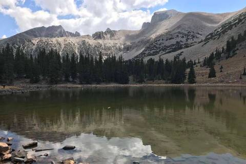 Jeff Davis Peak, left, and Wheeler Peak reflect in the waters of Stella Lake at Great Basin Nat ...