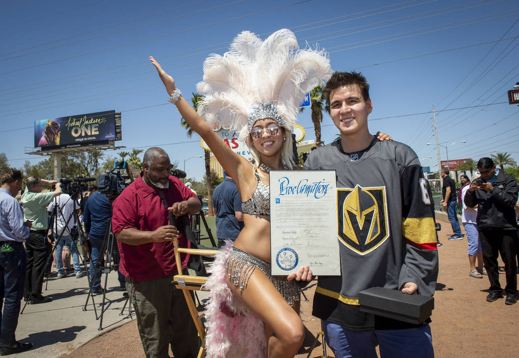 """Heather Neckritz, left, poses for a photograph with """"Jeopardy!"""" sensation James Holzhauer after ..."""