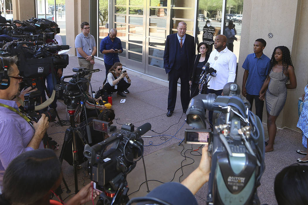 Rev. Jarrett Maupin, center, a civil rights advocate, speaks during a news conference as Dravon ...