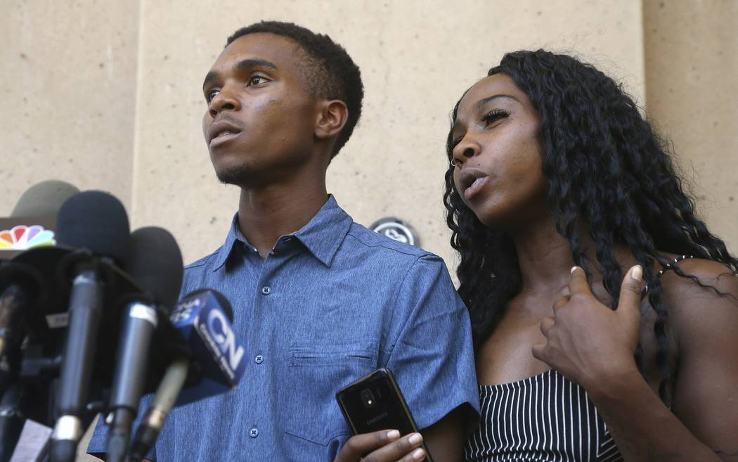Iesha Harper, right, answers a question during a news conference as she is joined by her fiance ...
