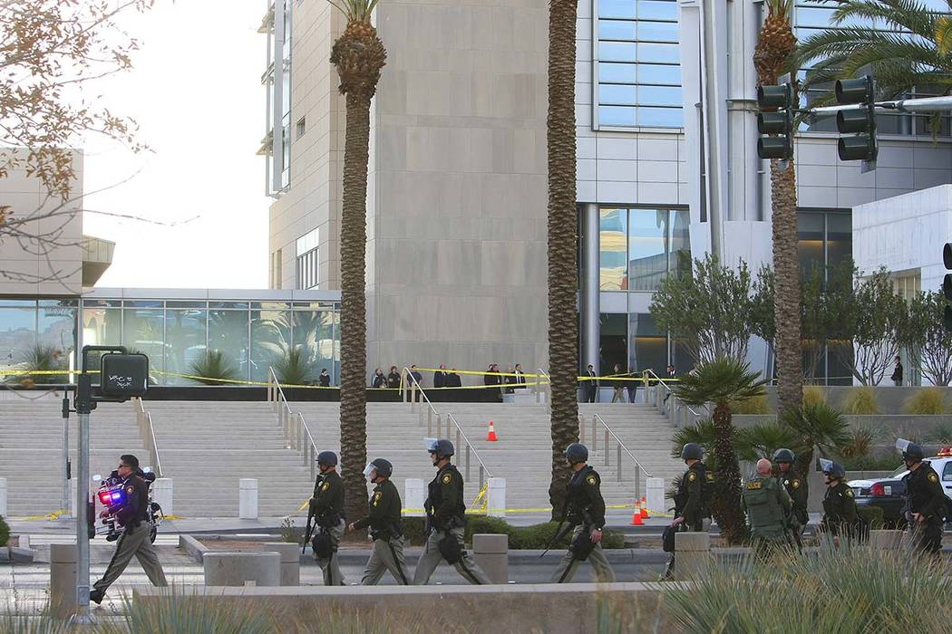 Las Vegas police spread out to search for a suspect involved in a shooting in the Lloyd George ...