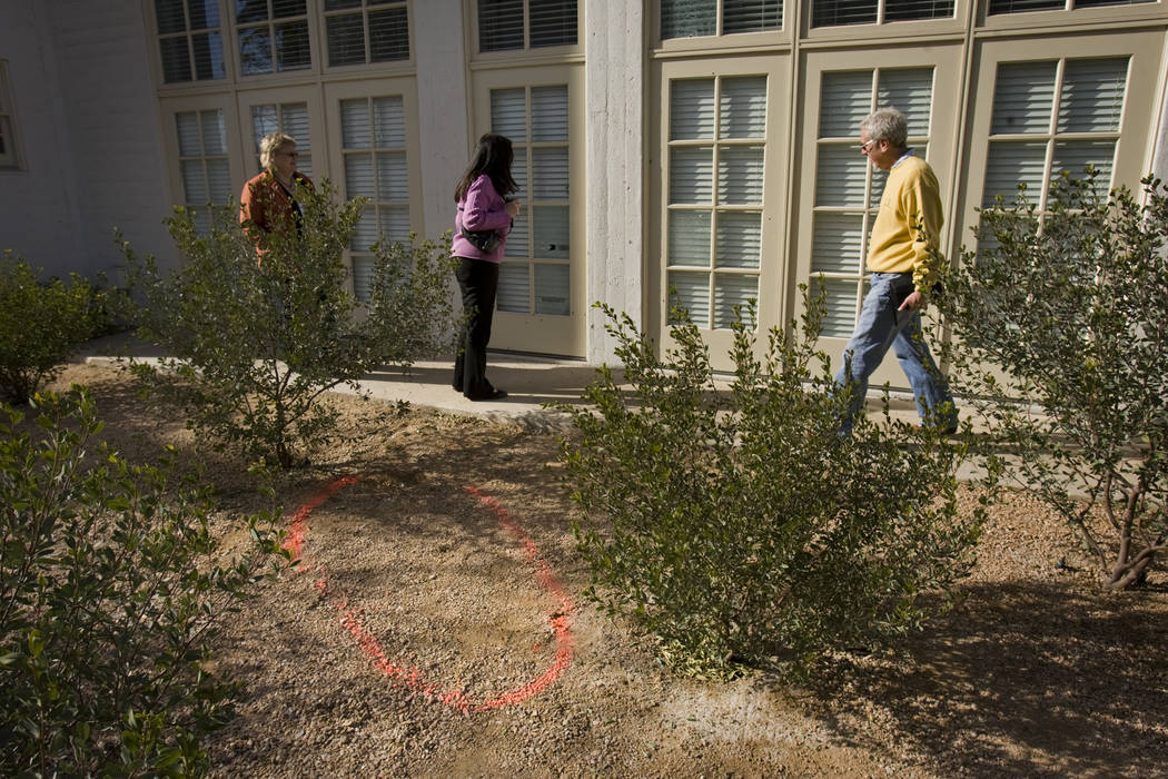 A paint outline marks the spot Tuesday, Jan. 5, 2010 where Johnny Lee Wicks was shot and killed ...