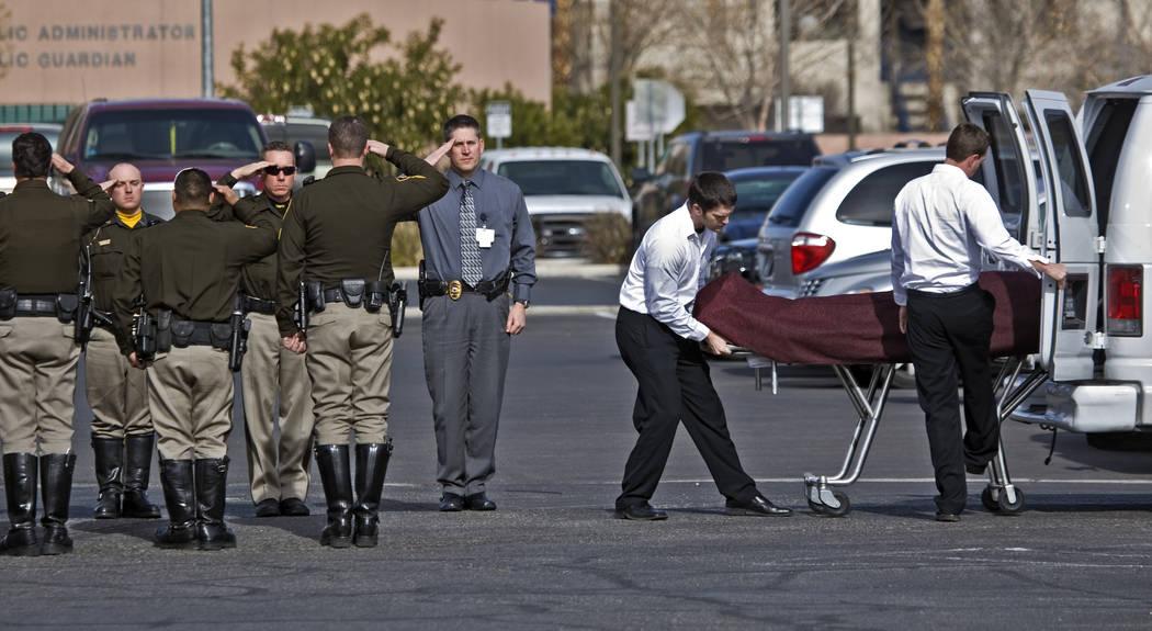 JEFF SCHEID/LAS VEGAS REVIEW-JOURNAL Las Vegas police officers form an honor guard for a slai ...