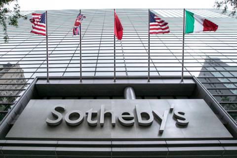 Flags fly on the front of Sotheby's auction house, in New York, Monday, June 17, 2019. BidFair ...