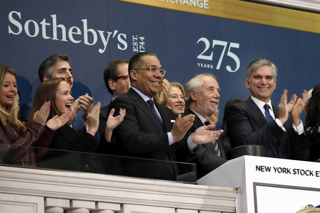 FILE - In this March 11, 2019, file photo Sotheby's Chairman Domenico De Sole, second from righ ...