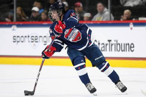 Team Leopold forward Cole Caufield (14) makes a pass during the USA Hockey All-American Prospec ...