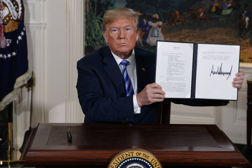 In a May 8, 2018, file photo President Donald Trump shows a signed Presidential Memorandum afte ...