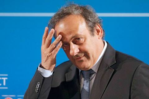 In a Feb.22, 2014, file photo, UEFA President Michel Platini arrives at a press conference in N ...