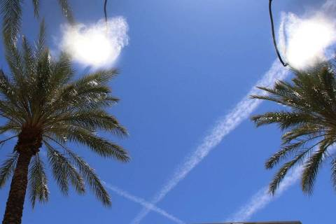 A water mister and multiple jet streams are seen on a hot day in Henderson. (Bizuayehu Tesfaye/ ...