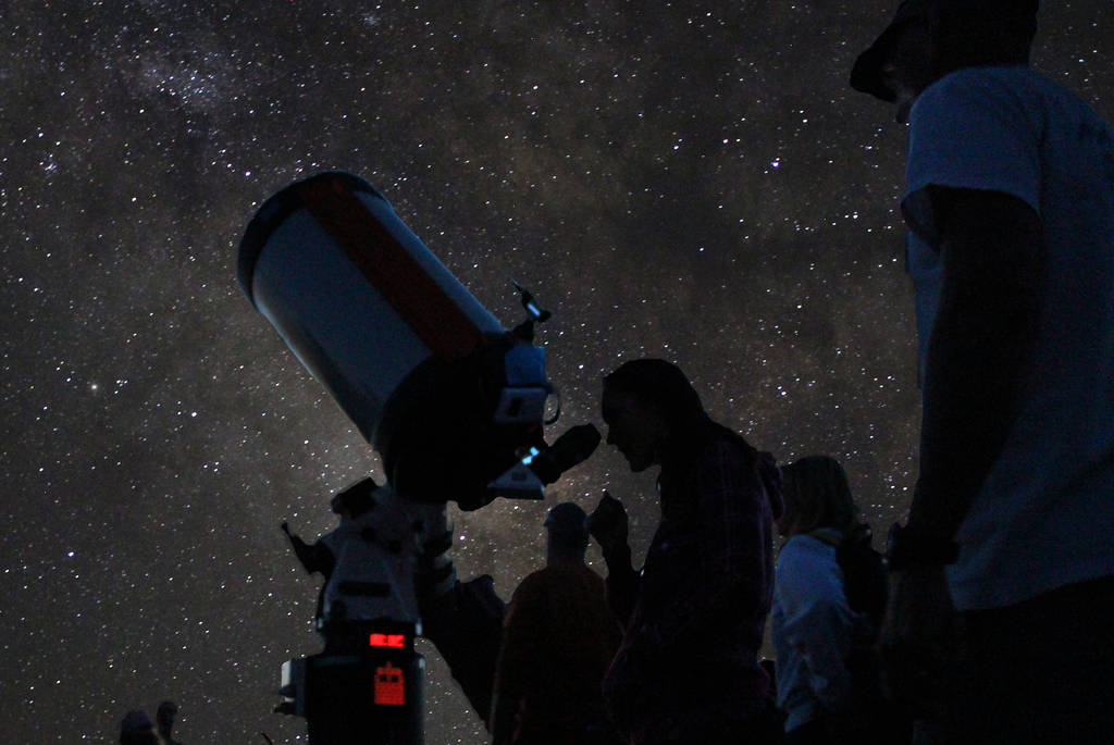 An amateur astronomer looks through a telescope at Grand Canyon National Park during the annu ...