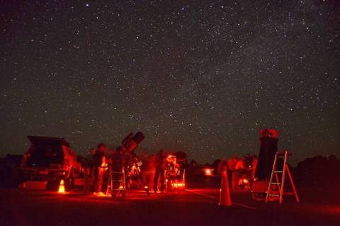 Red lights illuminate telescopes and stargazers during the annual Star Party at Grand Canyon Na ...