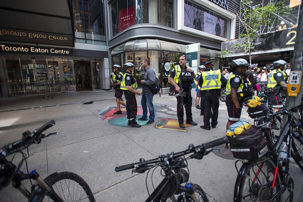 Toronto Police secure a crime scene after shots were fired during the Toronto Raptors NBA baske ...