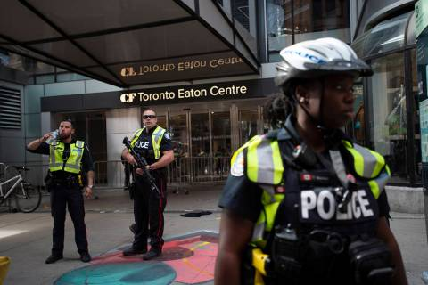 Toronto Police secure the scene where shots were fired during the Toronto Raptors NBA basketbal ...
