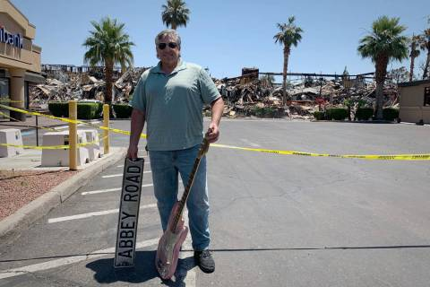 Richard Gacovino, 54, poses with two props from his television studio that he found on Tuesday, ...