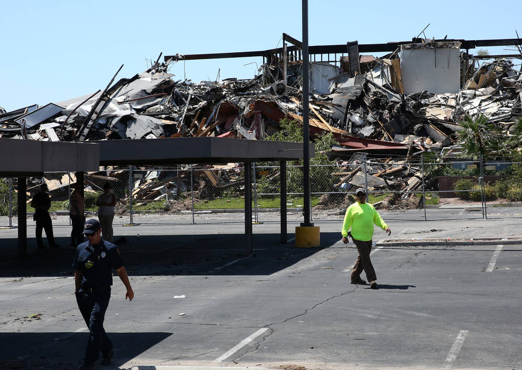 The rubble of burned-out office building at The Park at 3900 Paradise Road is seen on Tuesday, ...