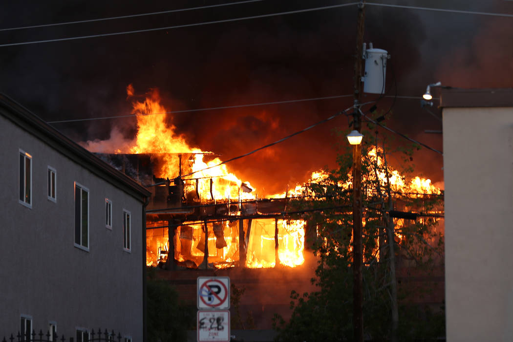An early morning fire engulfs a business complex near Paradise Road and East Twain Avenue in La ...