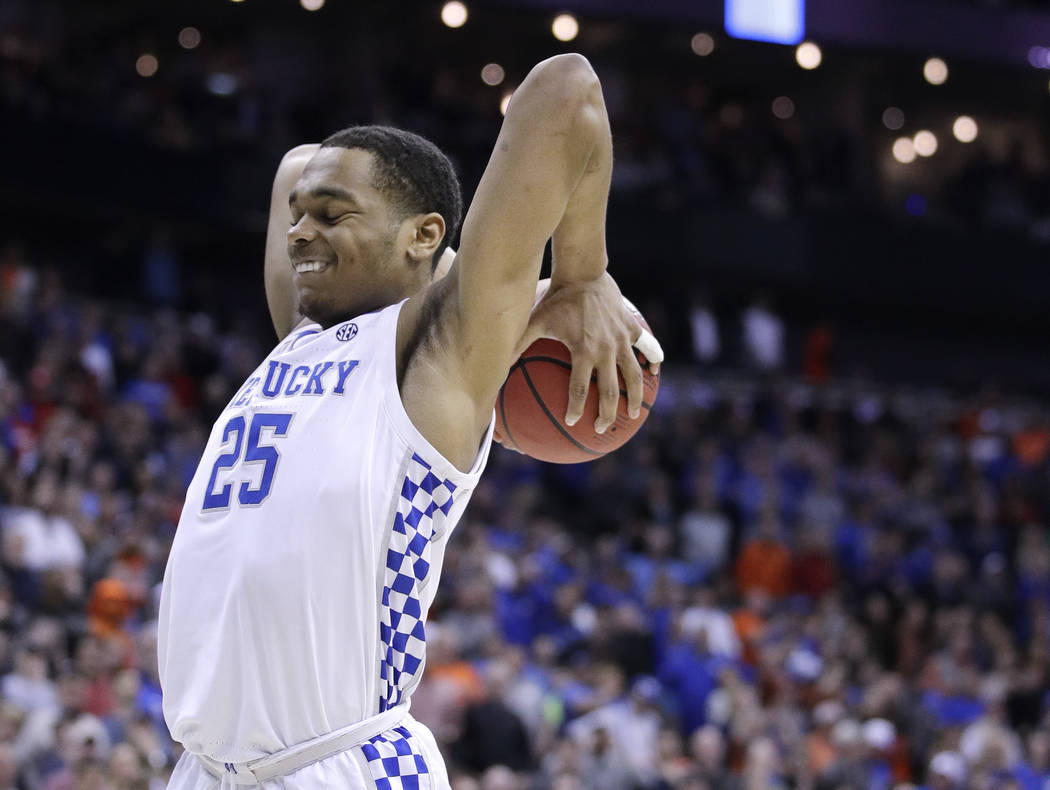Kentucky's PJ Washington reacts after missing a basket during overtime of the Midwest Regional ...