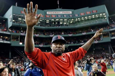 In this Oct. 10, 2016, file photo, Boston Red Sox's David Ortiz waves from the field at Fenway ...