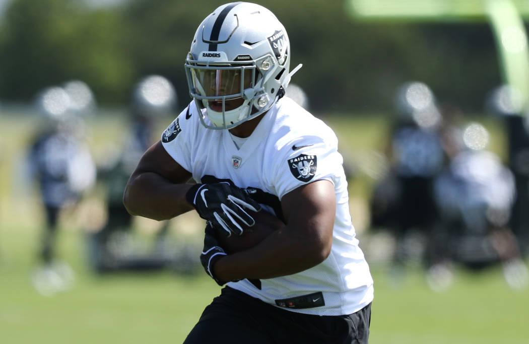 Oakland Raiders running back Josh Jacobs (28) runs with the football during an offseason traini ...