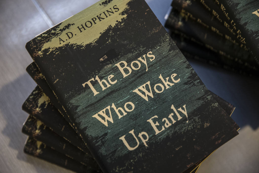 """Copies of A.D. Hopkins novel """"The Boys Who Woke Up Early"""" during a book release party ..."""