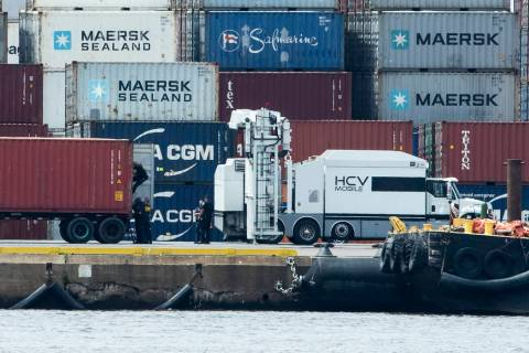 Authorities search a container along the Delaware River in Philadelphia, Tuesday, June 18, 2019 ...