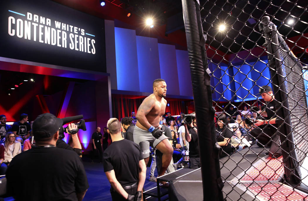 Yorgan De Castro runs into the octagon to take on Alton Meeks in their heavyweight bout on the ...