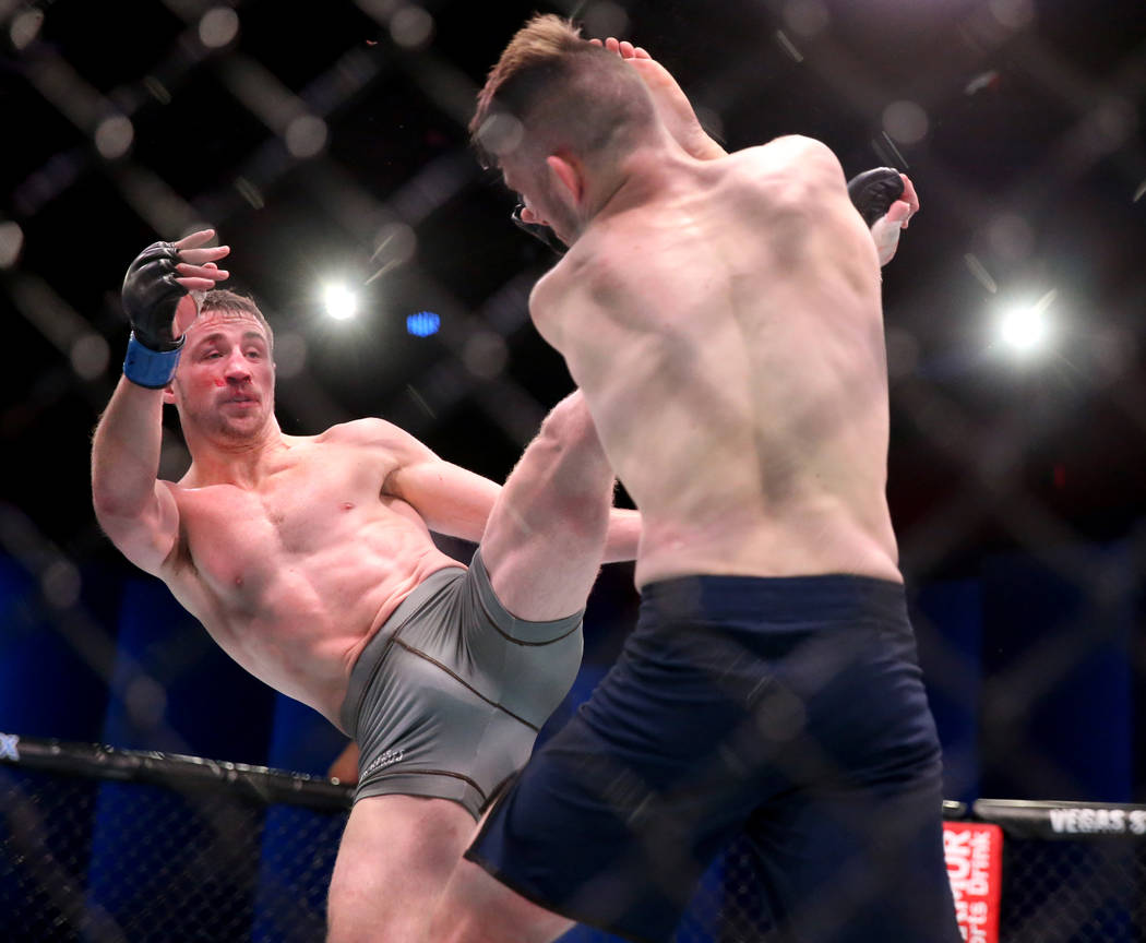 Brendan Loughnane lands a kick to Bill Algeoin the second round of their featherweight bout on ...