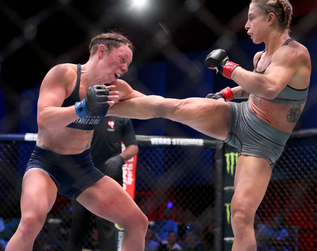 Hannah Goldy lands a kick to Kali Robbins in the second round of their strawweight bout on the ...