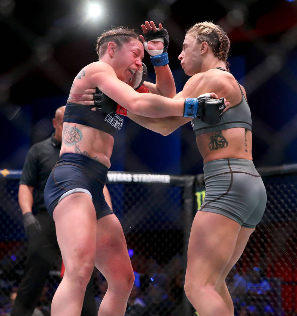Hannah Goldy lands a punch to Kali Robbins in the second round of their strawweight bout on the ...