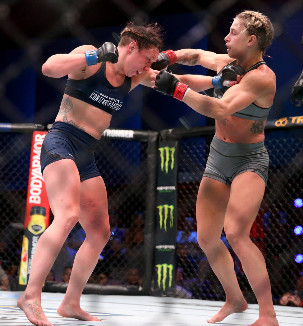 Hannah Goldy lands a punch to Kali Robbins in the third round of their strawweight bout on the ...