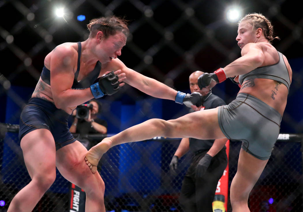 Hannah Goldy lands a kick to Kali Robbins in the third round of their strawweight bout on the o ...