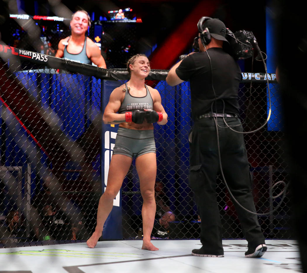 Hannah Goldy reacts after fighting Kali Robbins in their strawweight bout on the opening week o ...