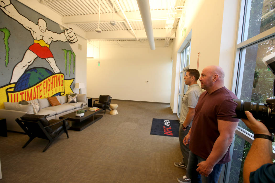 Ultimate Fighting Championship President Dana White, right, gives a tour of the new UFC Apex in ...