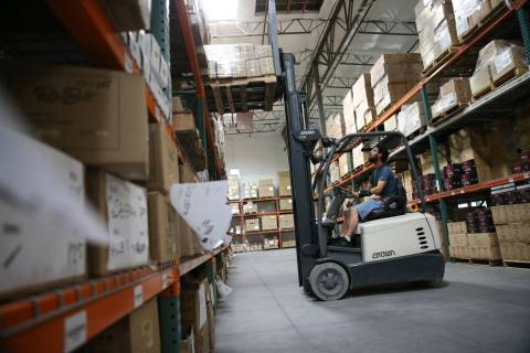 Warehouse associate Thomas Shirley works a fork lift at the Retro Manufacturing headquarters in ...