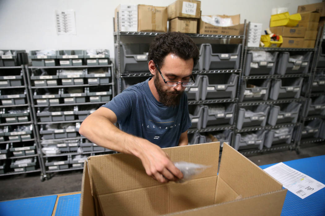 Warehouse associate Thomas Shirley fills an order at Retro Manufacturing headquarters in Hender ...