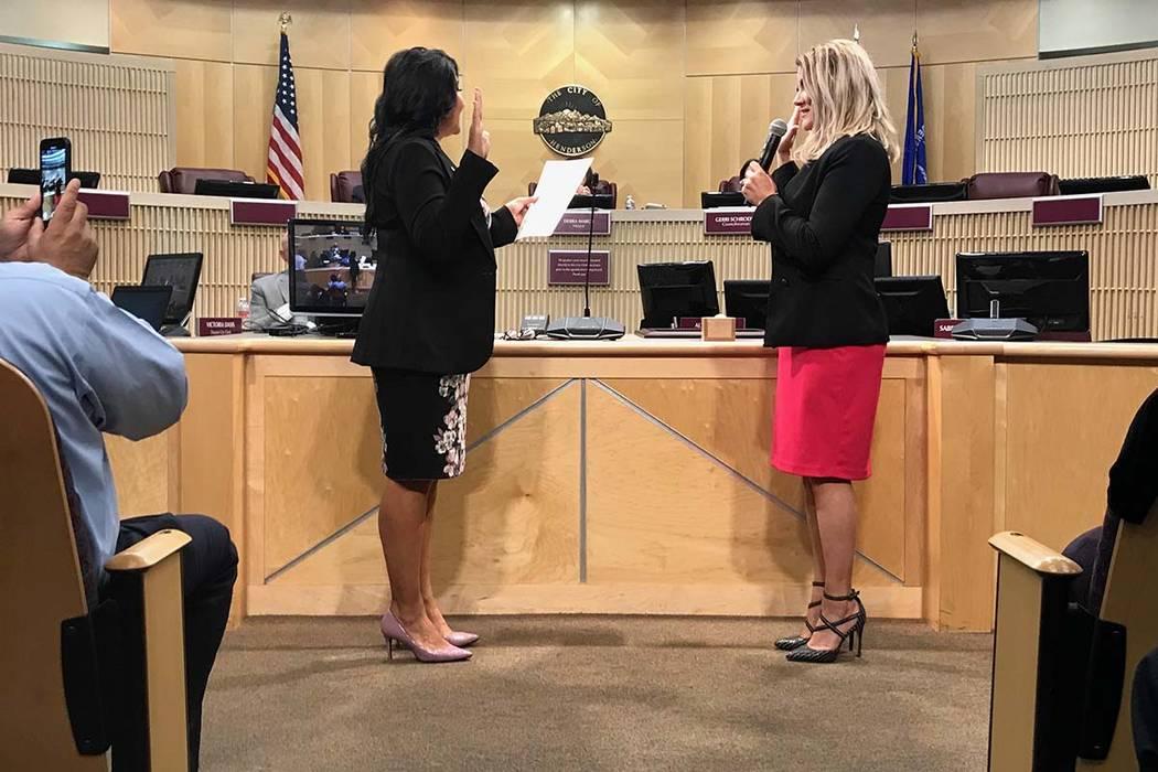 Henderson City Councilwoman Michelle Romero, right, representing Ward 1, recites her oath of of ...