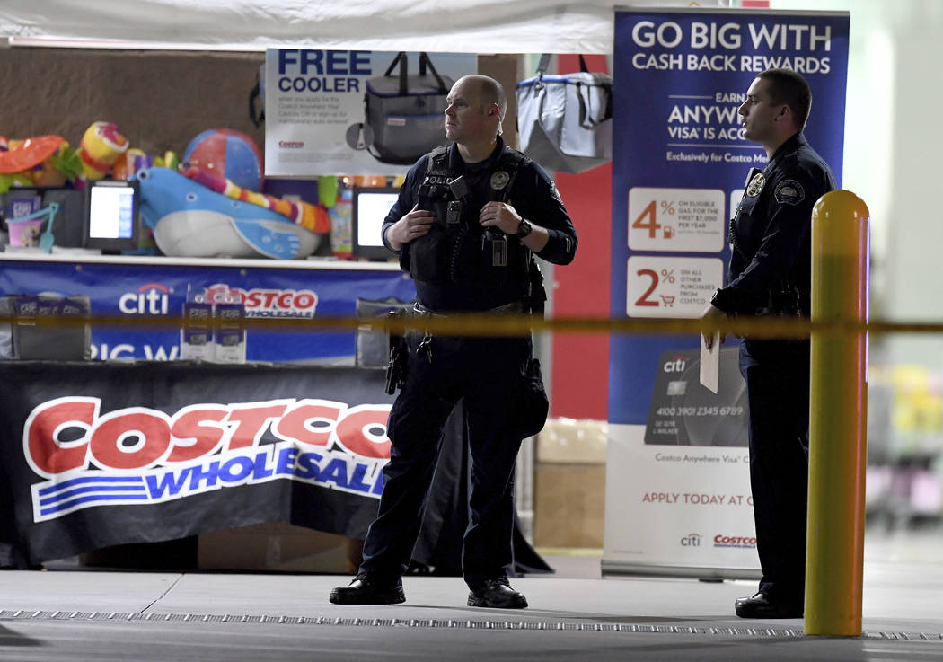 The Corona police department investigate a shooting inside a Costco in Corona, Calif., Friday, ...