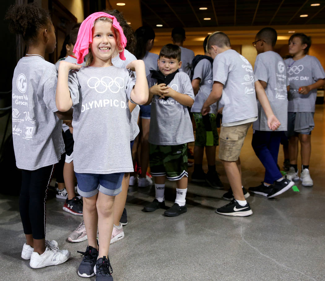 Braelynn Schoen, 8, of Southern Highlands Boys & Girls Club, prepares for Olympic Day at The Or ...