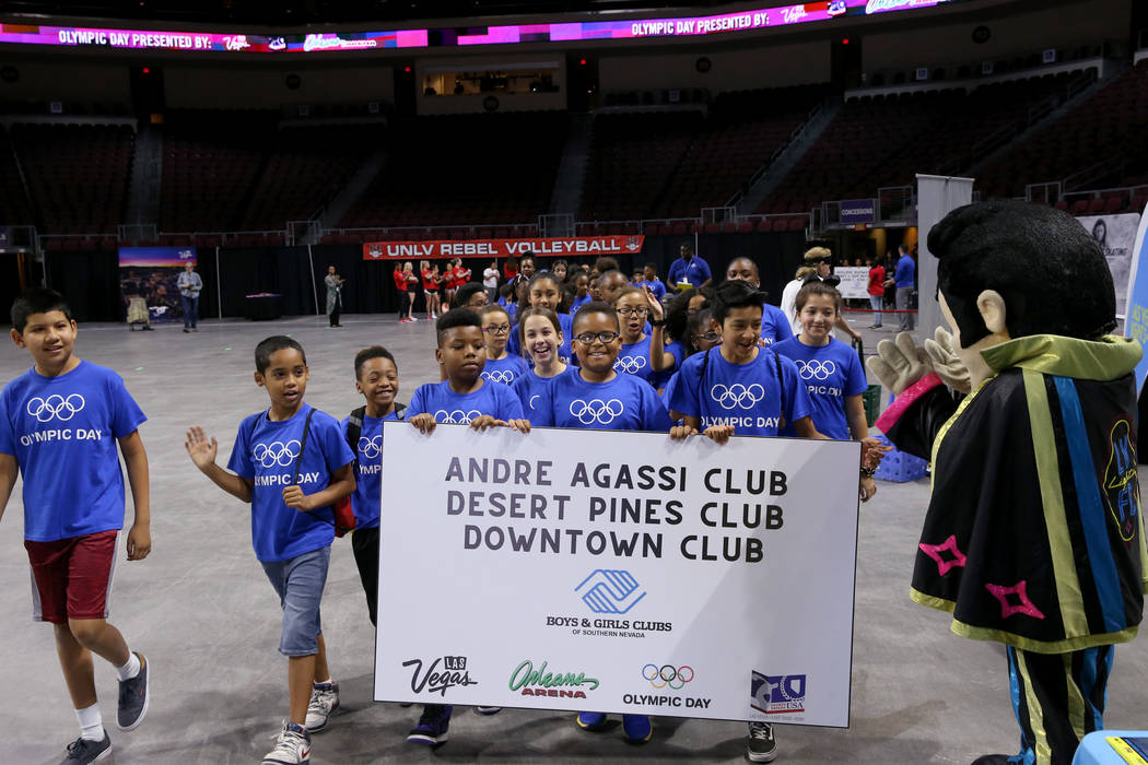 Andre Agassi, Desert Pines and Downtown Boys & Girls Clubs march in the procession on Olymp ...
