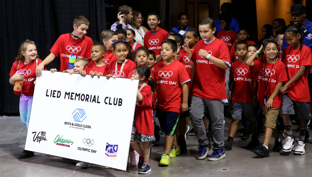 Lied Memorial Boys & Girls Club members march in the procession on Olympic Day at the Orlea ...