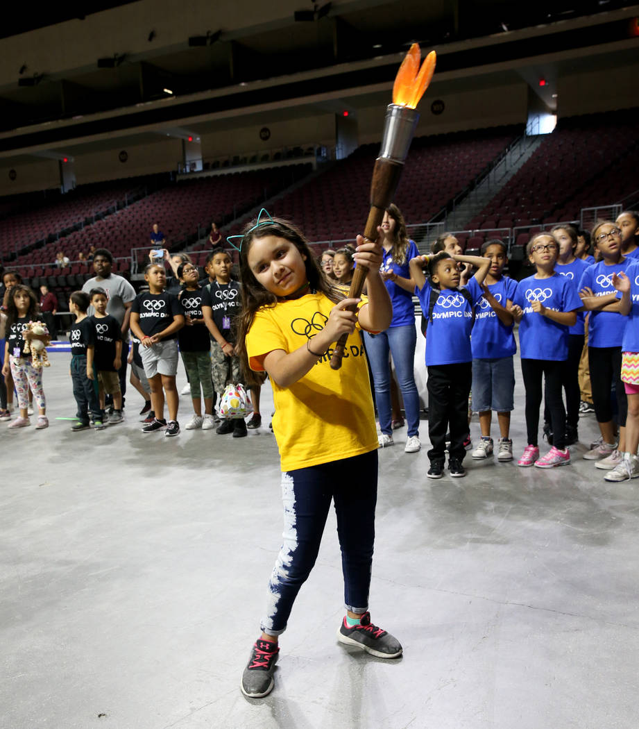 Arian Diaz Medina, 8, carries the torch on Olympic Day at The Orleans in Las Vegas Tuesday, Jun ...