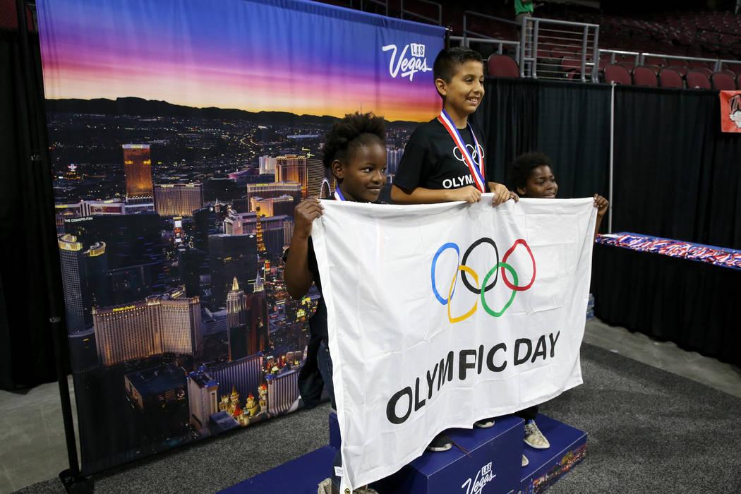 Semajanae Griffin, 9, from left, Luis Delgadillo, 11, and Kemaj Griffin 9, pose on the podium o ...