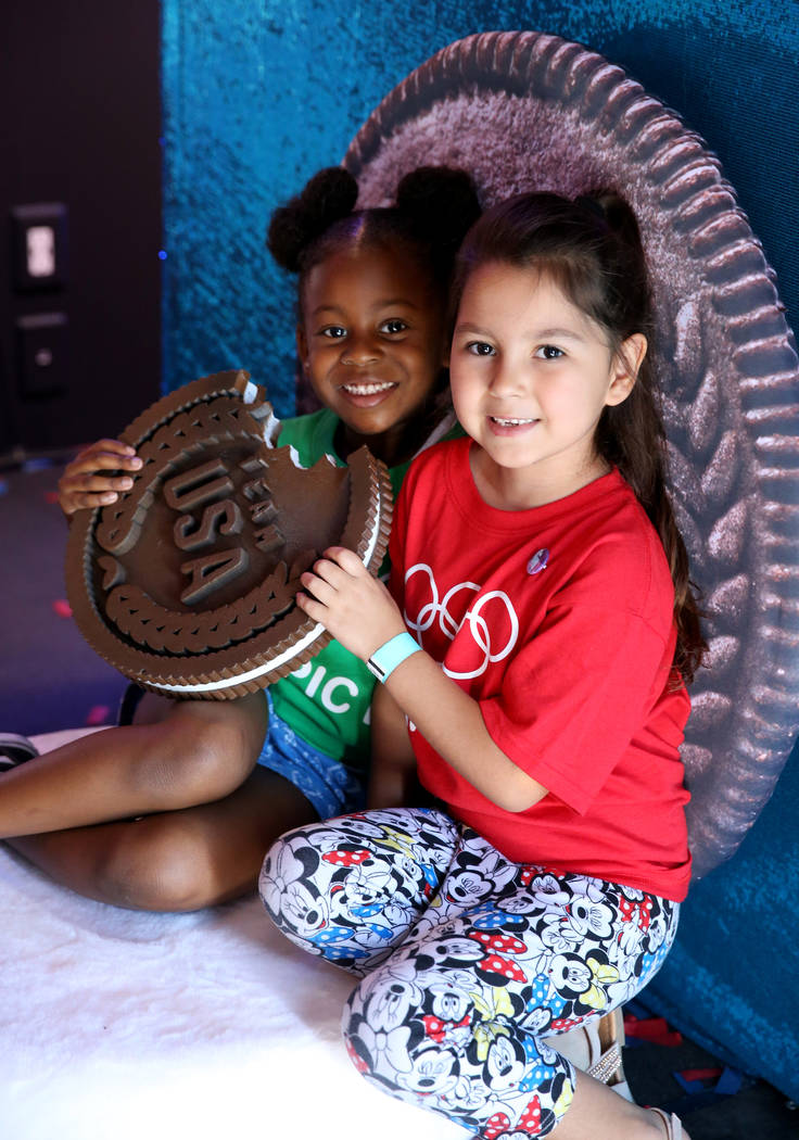 Khilyne Vergo, 6, and Arianny Martinez, 5, pose in the Team USA Social Experience Truck on Olym ...